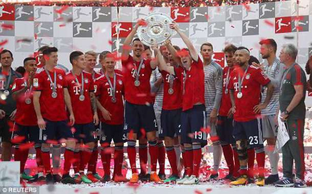 bayern-munich-players-celebrate-bundesliga-title-with-beer-football
