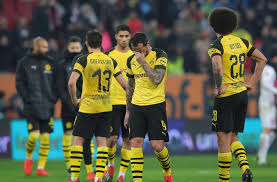 dortmund with we suxked look on their face